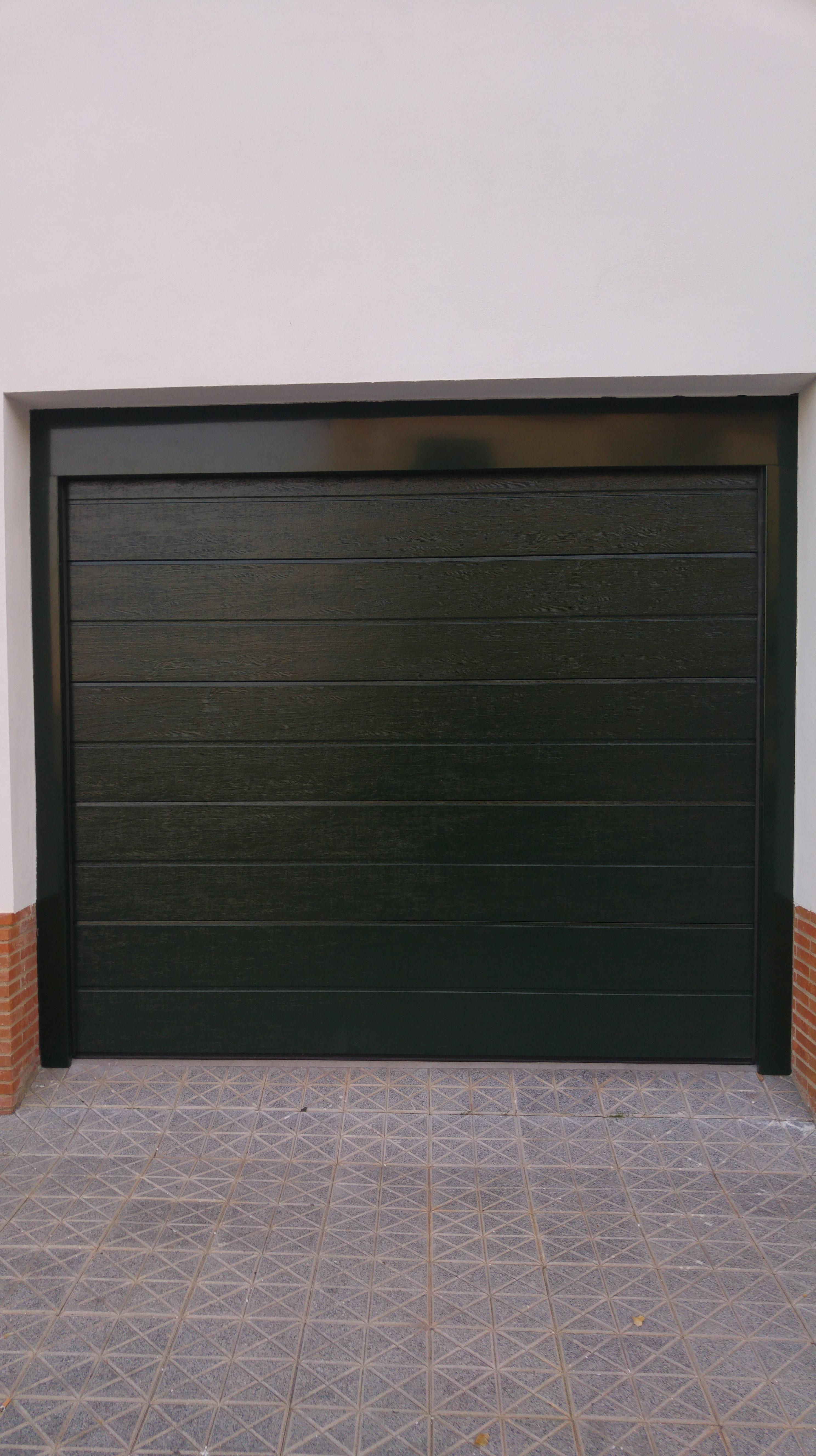 Puertas de garaje y cancelas puertas automaticas mena for Puertas automaticas garaje